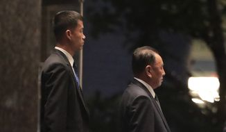 Kim Yong-chol, right, former North Korean military intelligence chief and one of leader Kim Jong-un's closest aides, walks to his car after a dinner with U.S. Secretary of State Mike Pompeo, Wednesday, May 30, 2018, in New York. (AP Photo/Julie Jacobson)