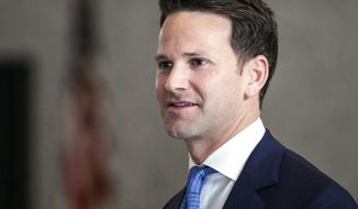 In this April 18, 2018, photo, former U.S. Rep. Aaron Schock walks out of the Dirksen Federal Building in Chicago. The 7th U.S. Circuit Court of Appeals in Chicago on Wednesday, May 30, 2018, refused to toss corruption charges against Schock, saying it can't assess whether his prosecution violated constitutional separation-of-powers clauses until after he goes to trial. The Republican from the central Illinois city of Peoria was indicted in 2016 on charges of misusing funds. (Ashlee Rezin/Sun Times via AP)