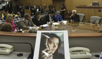 FILE - In this March 25, 2015, file photo, a portrait of Brittany Maynard sits on the dais of the Senate Health Committee as lawmakers heard testimony on proposed legislation allowing doctors to prescribe life-ending medication to terminally ill patients, at the Capitol in Sacramento, Calif. A California law allowing terminally ill people to end their lives was blocked following a judge's ruling that the measure was not legally approved by the Legislature. Since last week's decision, doctors have stopped issuing new prescriptions for life-ending drugs. Many issues are unclear, however, such as what could happen to the insurance claims of relatives of terminally ill patients who take drugs they legally obtained when the law was in effect. (AP Photo/Rich Pedroncelli, File)