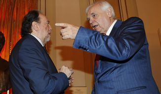 Italian conductor Riccardo Chailly, left, and La Scala's general director Alexander Pereira talk prior to the start of the press conference to present the 2018/2019 season, in Milan, Italy, Wednesday, May 30, 2018. (AP Photo/Antonio Calanni)