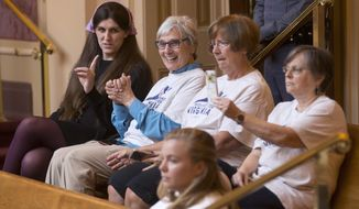 Del. Danica Roem, D-Prince William, left, talks with supporters of Medicaid expansion as they celebrate a vote in the gallery of the Virginia Senate at the Capitol in Richmond, Va., Wednesday, May 30, 2018. (AP Photo/Steve Helber)