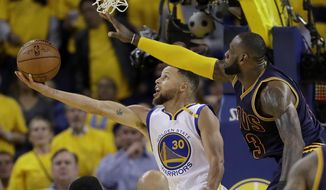 FILE - In this June 1, 2017, file photo, Golden State Warriors guard Stephen Curry (30) shoots against Cleveland Cavaliers forward LeBron James during the second half of Game 1 of basketball's NBA Finals in Oakland, Calif. Game 1 of the 2018 NBA Finals between the Warriors and Cavaliers is Thursday, May 31. (AP Photo/Marcio Jose Sanchez, File) **FILE**