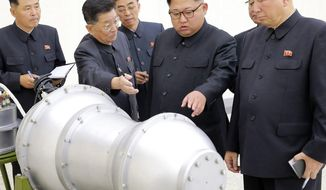 FILE - This undated file photo distributed on Sunday, Sept. 3, 2017, by the North Korean government, shows North Korean leader Kim Jong Un, second from right, at an undisclosed location. When U.s. President Donald Trump and Kim meet in Singapore in June 2018, they will have two very different agendas. Kim would love to keep his nukes. And Trump would love to take them all away, ASAP. Independent journalists were not given access to cover the event depicted in this image distributed by the North Korean government. The content of this image is as provided and cannot be independently verified. (Korean Central News Agency/Korea News Service via AP, File)