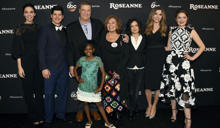 "FILE - In this March 23, 2018 file photo, from left, Whitney Cummings, Michael Fishman, John Goodman, Jayden Rey, Roseanne Barr, Sara Gilbert, Sarah Chalke and Emma Kenney arrive at the Los Angeles premiere of ""Roseanne"" in Burbank, Calif.  ABC has canceled its hit reboot of ""Roseanne"", Tuesday, May 29,  following Roseanne Barr's racist tweet about former Obama adviser Valerie Jarrett. ABC Entertainment President Channing Dungey says the comment ""is abhorrent, repugnant and inconsistent with our values, and we have decided to cancel the show.""  (Photo by Jordan Strauss/Invision/AP, File)"