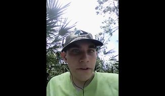 In this image made from one of three videos released Wednesday, May 30, 2018, by the Broward County State Attorney's Office, Nikolas Cruz, the suspect in February's shooting at a Florida high school, announces his intention to become the next school shooter, aiming to kill at least 20 people. The videos were found on Cruz's cellphone after the Feb. 14 shooting at Marjory Stoneman Douglas High School that killed 17 people and injured 17 others. (Broward County State Attorney's Office via AP)