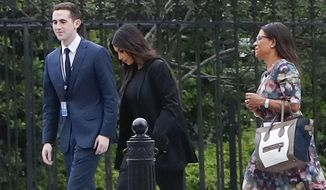 Kim Kardashian, center, arrives with her attorney Shawn Chapman Holley at the security entrance of the White House in Washington, Wednesday, May 30, 2018. (AP Photo/Pablo Martinez Monsivais)