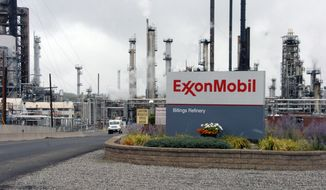 FILE - This Sept. 21, 2016, file photo shows Exxon Mobil's Billings Refinery in Billings, Mont. New trails, fishing sites and other recreational features will be built along Montana's Yellowstone River as compensation for damage from an Exxon Mobil Corp. pipeline spill, under a plan approved Wednesday, May 30, by the governor. (AP Photo/Matthew Brown, File)