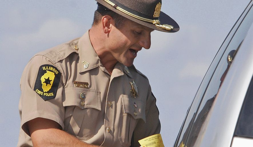 llinois State Police officer Sgt. Mike Vorreyer issues a ticket for speeding to a motorist on Interstate Highway 72 near Jacksonville, Ill., on Sept. 15, 2006. (Associated Press) **FILE**