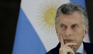 FILE - In this March 6, 2018 file photo, Argentina's President Mauricio Macri attends a luncheon at the government house Casa Rosada, in Buenos Aires, Argentina. Argentina's government on Thursday, May 31, 2018, vetoed a measure that would have capped increases in gas, electricity and water rates. (AP Photo/Natacha Pisarenko, File)
