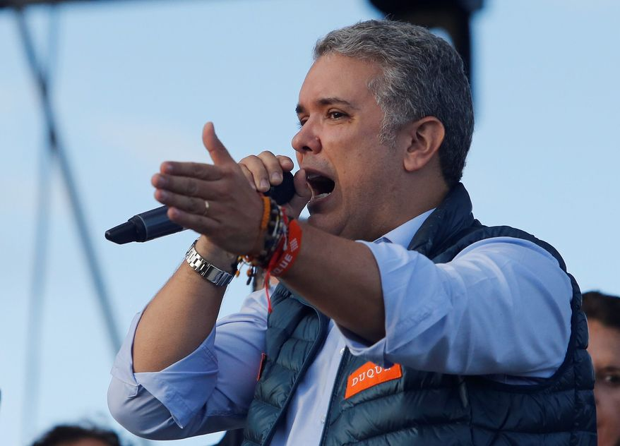 Ivan Duque, presidential candidate for Democratic Center party, holds a campaign rally in Bogota, Colombia, Sunday, May 20, 2018. Colombians will go to the polls on May 27 for a first round presidential election. (AP Photo/Fernando Vergara)