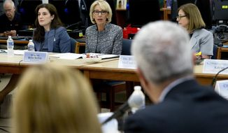Education Secretary Betsy DeVos speaks during a visit of the Federal School Safety Commission at Hebron Harman Elementary School in Hanover, Md., Thursday, May 31, 2018. (AP Photo/Jose Luis Magana)