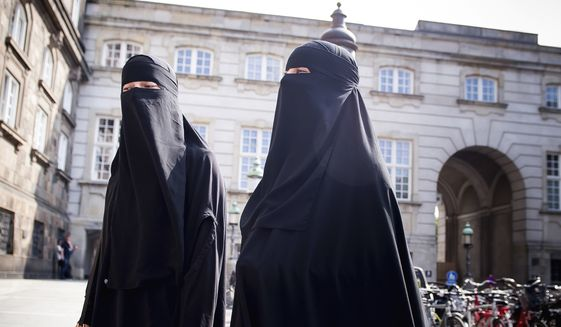 Women in niqab walk, in Copenhagen, Denmark, Thursday May 31. 2018. (Mads Claus Rasmussen/Ritzau Scanpix via AP) ** FILE **