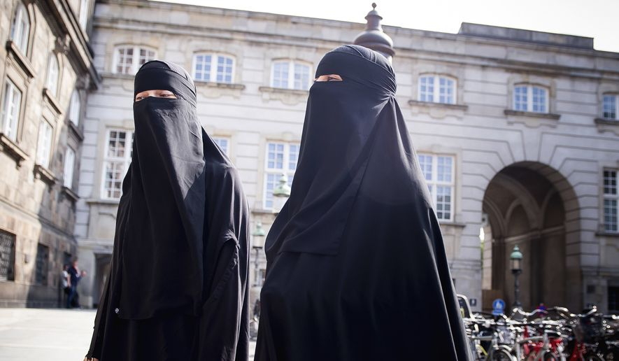 Women in niqab walk, in Copenhagen, Denmark, Thursday May 31. 2018. (Mads Claus Rasmussen/Ritzau Scanpix via AP) ** FILE **