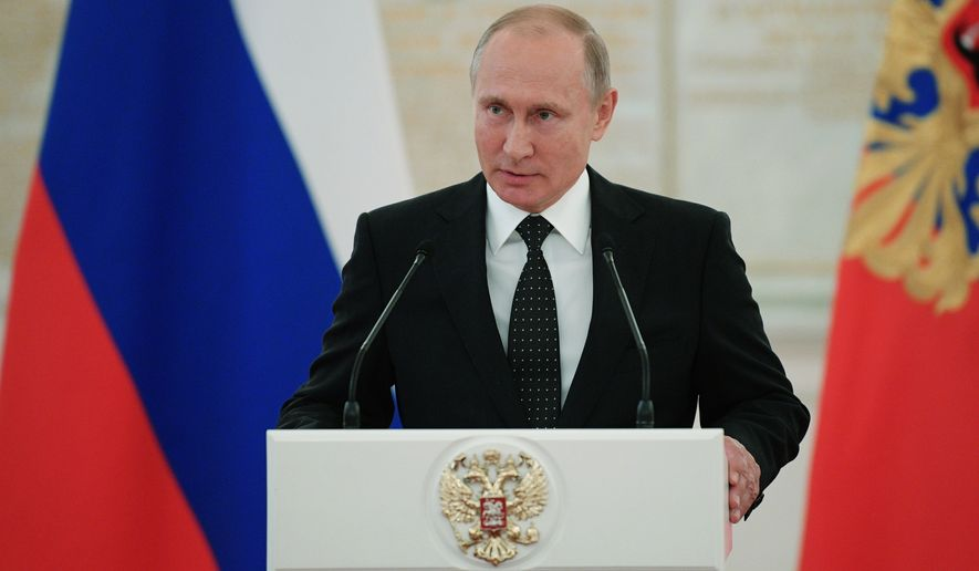 Russian President Vladimir Putin speaks during a meeting with senior officers and prosecutors in the Kremlin in Moscow, Russia, Thursday, May 31, 2018. (Alexei Druzhinin, Kremlin Pool Photo via AP)