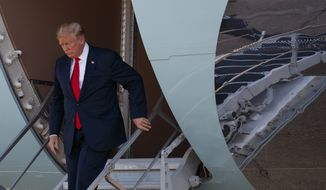 President Donald Trump walks down the steps of Air Force One after arriving at Dallas Love Field airport, Thursday, May 31, 2018, in Dallas. (AP Photo/Evan Vucci)