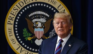 """President Donald Trump arrives for a bill signing ceremony for the """"Right to Try"""" act in the South Court Auditorium on the White House campus, Wednesday, May 30, 2018, in Washington. (AP Photo/Evan Vucci)"""