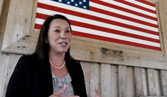 U.S. Representative Martha Roby pauses to talk with the media while campaigning at a fish fry in Andalusia, Ala., on Wednesday May 30, 2018. (Mickey Welsh /The Montgomery Advertiser via AP)