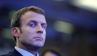 """French President Emmanuel Macron attends the OECD ministerial council meeting on """"Refounding Multilateralism"""", in Paris, France, Wednesday, May 30, 2018. Macron warned against trade wars in an impassioned speech about international cooperation Wednesday, two days before the Trump administration decides whether to hit Europe with punishing new tariffs. (Philippe Wojazer/Pool Photo via AP)"""