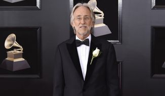 FILE - In this Jan. 28, 2018 file photo, Neil Portnow arrives at the 60th annual Grammy Awards in New York. Portnow will step down as president and CEO of The Recording Academy and the Grammy Awards next year. The organization announced Thursday, May 31, that Portnow chose not to seek an extension on his current contract, which ends next year. He has led the academy since 2002. (Photo by Evan Agostini/Invision/AP, File)
