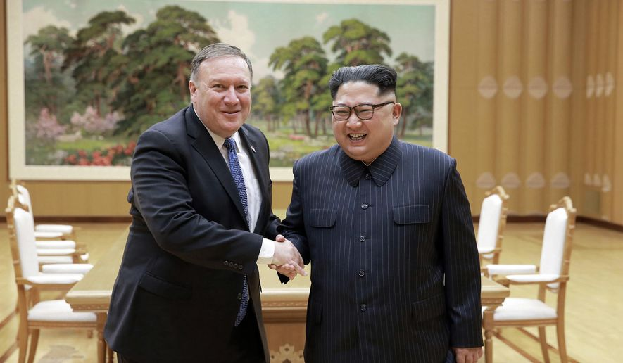 "In this May 9, 2018, file photo provided by the North Korean government, U.S. Secretary of State Mike Pompeo, left, shakes hands with North Korean leader Kim Jong-un during a meeting at Workers' Party of Korea headquarters in Pyongyang, North Korea. Korean language watermark on image as provided by source reads: ""KCNA"" which is the abbreviation for Korean Central News Agency. (Korean Central News Agency/Korea News Service via AP, File)"