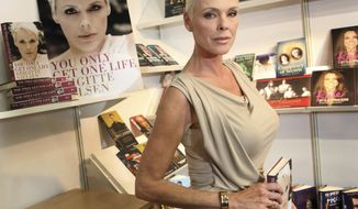 """FILE - In this April 11, 2011 file photo,  actress Brigitte Nielsen launches her autobiography, """"You Only Get One Life"""", at the London Book Fair, Earl's Court Exhibition Centre, London.   Nielsen is pregnant with her fifth child. The actress posted photos of her baby bump on Instagram and Twitter.   (AP Photo/Joel Ryan, File)"""