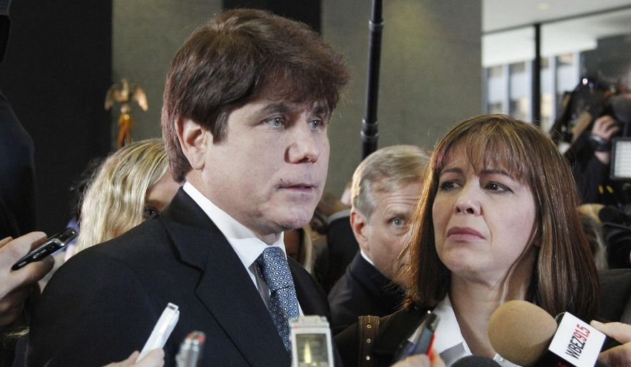 In this Dec. 7, 2011 file photo, former Illinois Gov. Rod Blagojevich, left, speaks to reporters as his wife, Patti, listens at the federal building in Chicago. President Donald Trump says he is considering commuting the sentence of ex- Gov. Blagojevich and pardoning Martha Stewart. The comments came aboard Air Force One on Thursday, May 31, 2018, after he tweeted that he planned to pardon conservative commentator Dinesh D'Souza. Blagojevich, a Democrat, began serving his 14-year prison sentence on corruption convictions in 2012.  (AP Photo/M. Spencer Green, File)