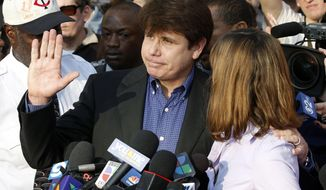 FILE - In this March 14, 2012 file photo, former Illinois Gov. Rod Blagojevich, with his wife Patti at his side, speaks to the media in Chicago before reporting to federal prison in Denver. President Donald Trump says he is considering commuting the sentence of ex- Gov. Blagojevich and pardoning Martha Stewart. The comments came aboard Air Force One on Thursday, May 31, 2018, after he tweeted that he planned to pardon conservative commentator Dinesh D'Souza. Blagojevich, a Democrat, began serving his 14-year prison sentence on corruption convictions in 2012. (AP Photo/M. Spencer Green, File)