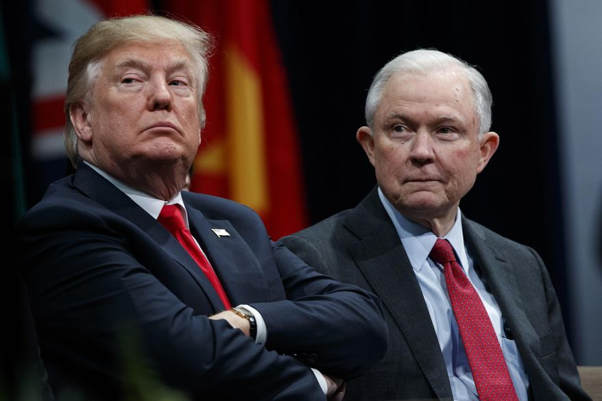 President Donald Trump sits with Attorney General Jeff Sessions during the FBI National Academy graduation ceremony in Quantico, Va., on Dec. 15, 2017. (Associated Press) **FILE**