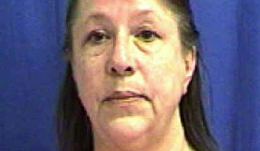 This May 31, 2018, photo provided by the Muscatine County Jail in Muscatine, Iowa, shows Annette Dee Cahill. Cahill was arrested and charged with first-degree murder in the 1992 beating death of Corey Lee Wieneke, who was found dead on the floor of his bedroom in rural West Liberty, Iowa. (Muscatine County Jail via AP)