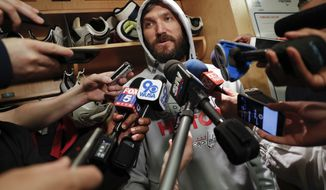 Washington Capitals left wing Alex Ovechkin speak to members of the media following team practice in Arlington, Va., Friday, June 1, 2018. Game 3 of the Stanley Cup NHL hockey finals between the Vegas Golden Knights and Capitals is scheduled for Saturday. (AP Photo/Pablo Martinez Monsivais) ** FILE **