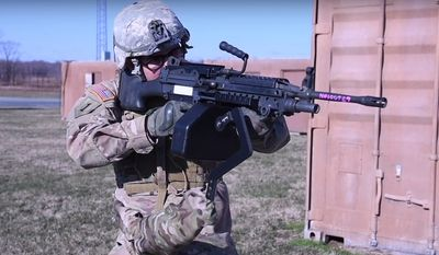 "The U.S. Army has released footage of its ""third arm"" prototype created by engineers from the U.S. Army Research Laboratory at Aberdeen Proving Ground, Maryland. (Image: YouTube, U.S. Army Research Laboratory)"