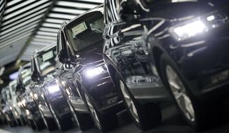 In this Thursday, March 8, 2018 photo Volkswagen cars are pictured during a final quality control at the Volkswagen plant in Wolfsburg, Germany. Germany's Volkswagen, Europe's largest automaker, is warning the Trump administration's decision to impose tariffs on aluminum and steel imports from Canada, Mexico, and the European Union could start a trade war that no side would win. (AP Photo/Michael Sohn)