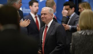 U.S. Attorney General Jeff Sessions is greeted as he arrives to deliver remarks at the Michigan Chapter of the Federalist Society's Annual Dinner & Grano Award Presentation at the Inn at St. John's, in Plymouth,  Mich., Thursday, May 31, 2018. (David Guralnick/Detroit News via AP)