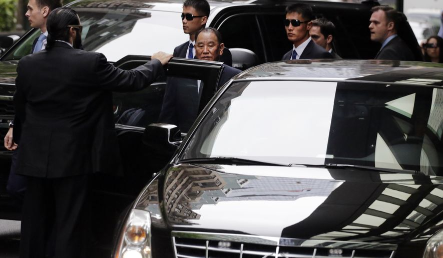 Kim Yong Chol, center, a top North Korean official, leaves his hotel for a meeting with U.S. Secretary of State Mike Pompeo, Thursday, May 31, 2018, in New York. Kim is in New York for talks aimed at salvaging a summit between Kim Jong Un and President Donald Trump, in the North's highest-level mission to the United States in 18 years. (AP Photo/Mark Lennihan)