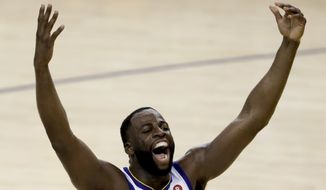 Golden State Warriors forward Draymond Green, celebrates during overtime of Game 1 of basketball's NBA Finals against the Cleveland Cavaliers in Oakland, Calif., Thursday, May 31, 2018. The Warriors won 124-114. (AP Photo/Marcio Jose Sanchez)