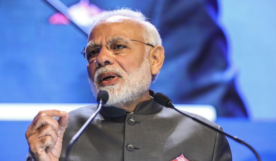 India's Prime Minister Narendra Modi delivers a keynote address at the opening dinner of the 17th IISS Shangri-la Dialogue, an annual defense and security forum in Asia, held in Singapore, Friday, June 1, 2018, in Singapore. (AP Photo/Yong Teck Lim)