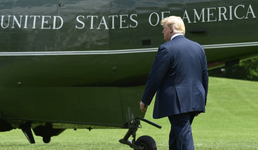 President Donald Trump walks to Marine One on the South Lawn of the White House in Washington, Friday, June 1, 2018,, as he heads to Camp David for the weekend. (AP Photo/Susan Walsh)