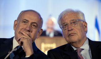 In this May 21, 2017, file photo, Israeli Prime Minister Benjamin Netanyahu, left and David Friedman, right, the new United States Ambassador to Israel attend a ceremony celebrating the 50th anniversary of the liberation and unification of Jerusalem, in front of the walls of the Old City of Jerusalem. AP sources say President Donald Trump is considering giving Friedman more authority over the U.S. outpost that handles Palestinian affairs, a shift likely to further dampen Palestinian hopes for an independent state. (Abir Sultan/Pool Photo via AP, File)