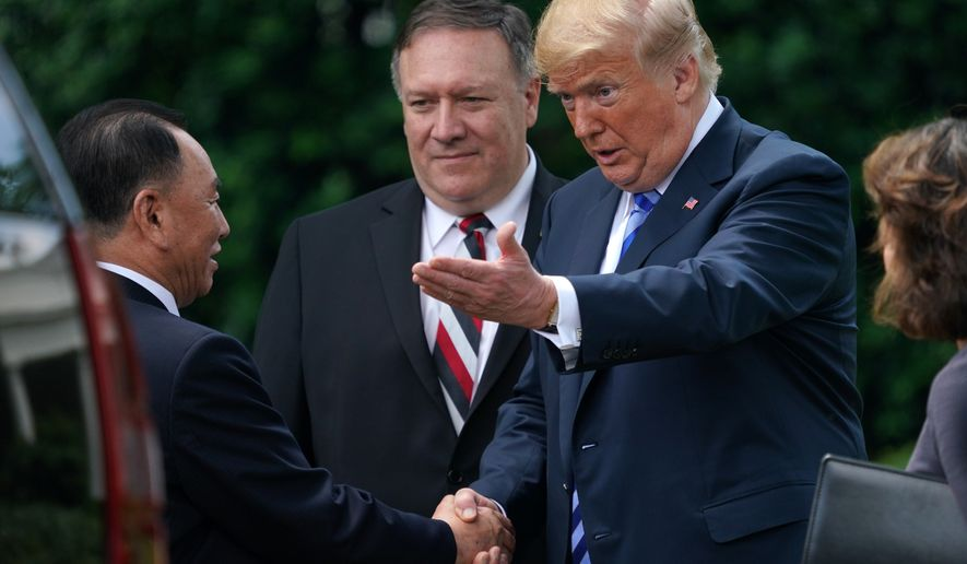President Donald Trump shakes hands with Kim Yong Chol, left, former North Korean military intelligence chief and one of leader Kim Jong Un's closest aides, after their meeting in the Oval Office of the White House in Washington, Friday, June 1, 2018, as Secretary of State Mike Pompeo listens at center. (AP Photo/Andrew Harnik)