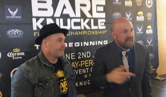 In this Thursday, May 31, 2018 photo, fighter Bobby Gunn, left, and Bryan Pedersen, chairman of the Wyoming State Board of Mixed Martial Arts, speak with reporters during a news conference to promote a bare-knuckle boxing event that is being held Saturday night at the Cheyenne Ice and Events Center in Wyoming. The event is being billed by the promoter as the first legal, regulated and sanctioned bare-knuckle fight event in history. Bare-knuckle fighting was the forerunner of modern boxing with the last major bare-knuckle fight being held more than 100 years ago. Since then it has been held mostly underground and out of sight. (AP Photo/Bob Moen)