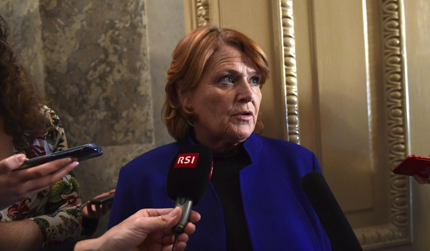 In this Jan. 22, 2018, file photo, Sen. Heidi Heitkamp, D-N.D., talks with reporters on Capitol Hill in Washington. (AP Photo/Susan Walsh, File)