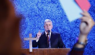 FILE - In this Friday, Dec. 8, 2017, file photo, evangelical preacher Franklin Graham speaks in Hanoi, Vietnam.  Graham says he is coming to Berkeley, Calif., Friday, June 1, 2018, in peace and in a longshot attempt to sway some voters to support evangelic Christian candidates. The outspoken supporter of President Donald Trump said he is in the middle of a 10-stop campaign-style tour of California ahead of the June 5 election that is designed to get out the evangelic Christian vote to defeat progressive politicians and insert more religion into government. (AP Photo/Hau Dinh, File)