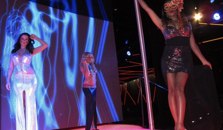 This Aug. 26, 2013 photo shows dancers at the Scores strip club inside the former Trump Taj Mahal casino in Atlantic City, N.J.. Scores and Robert's Steakhouse will return when the casino reopens as the Hard Rock on June 28, 2018. (AP Photo/Wayne Parry)