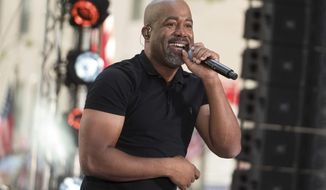 FILE - In this May 25, 2018 file photo, Darius Rucker performs on NBC's Today show at Rockefeller Plaza in New York. Country singers Rucker and Kane Brown are sharing a chart record as the first two solo acts who are also minorities to follow each other with No. 1 country songs in the 28-year history of the Billboard Country Airplay chart.  (Photo by Charles Sykes/Invision/AP, File)