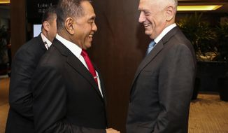 U.S. Defense Secretary Jim Mattis, right, meets with Indonesia's Defense Minister Ryamizard Ryacudu before their meeting with the Southeast Asian defense ministers at the 17th International Institute for Strategic Studies (IISS) Shangri-la Dialogue, an annual defense and security forum in Asia, in Singapore, Friday, June 1, 2018. (AP Photo/Yong Teck Lim)