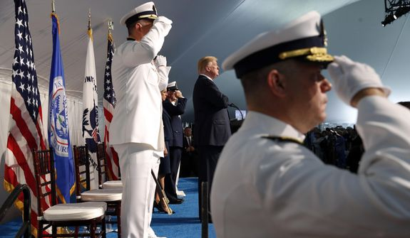 President Donald Trump, center, attends a Change of Command ceremony at the U.S. Coast Guard Headquarters, Friday, June 1, 2018, in Washington. Adm. Paul F. Zukunft will be relieved by Adm. Karl L. Schultz as the Commandant of the U.S. Coast Guard. (AP Photo/Jacquelyn Martin) ** FILE **
