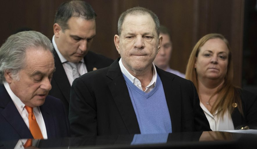 "FILE - In this May 25, 2018 file photo, Harvey Weinstein, center, listens during a court proceeding in New York during his arraignment on rape and other charges. On Friday, June 1, 2018, a new rape allegation was made against Weinstein as part of a lawsuit alleging he had help covering up his misconduct with women. Melissa Thompson says that when she was meeting with Weinstein in 2011 to pitch internet technology, he cornered her and ""out-muscled"" her as she tried to fight him off. (Steven Hirsch/New York Post via AP, Pool)"
