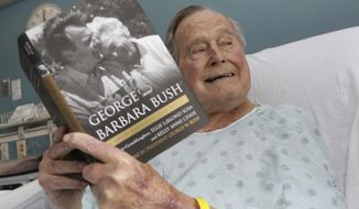 This photo provided by Office of George H. W. Bush shows a photo of former President George H.W. Bush that has tweeted on Friday, June 1, 2018 from his hospital bed while reading a book about himself and his late wife in Biddeford, Maine. The 41st president is 93 and is recovering in a Maine hospital after experiencing low blood pressure and fatigue.   Barbara Bush died in April at age 92. She was married to the former president for 73 years..(Paul Morse/Office of George H. W. Bush via AP)