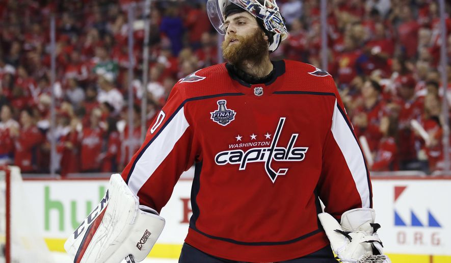 Washington Capitals goaltender Braden Holtby pauses during the third period in Game 3 of the NHL hockey Stanley Cup Final against the Vegas Golden Knights, Saturday, June 2, 2018, in Washington. (AP Photo/Alex Brandon)