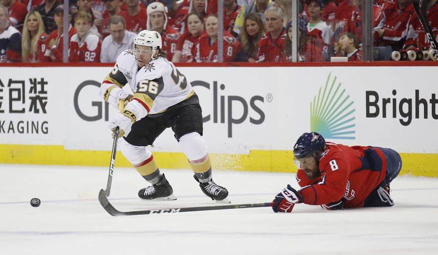 Vegas Golden Knights forward Erik Haula, left, of Finland, and Washington Capitals forward Alex Ovechkin, right, of Russia, try to control the puck during the first period in Game 3 of the NHL hockey Stanley Cup Final, Saturday, June 2, 2018, in Washington. (AP Photo/Alex Brandon) ** FILE **